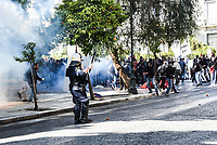 Tear gas used to help disperse teachers that have clashed with riot police in Athens