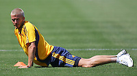 David Beckham stretches at his first practice with the LA Galaxy at the Home Depot Center in Carson, California, Monday, July 16, 2007.