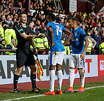 Joe Dodoo and James Tavernier with linesman after Rangers goal is disallowed