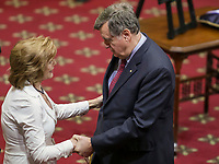 Former Quebec premier Lucien Bouchard gives his condolences to Lisette Lapointe, wife of former Quebec premier Jacques Parizeau, as her husband lies in state at the National Assembly in Quebec City on Sunday June 7, 2015.<br /> <br /> PHOTO :  Francis Vachon - Agence Quebec Presse