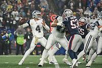 FOXBOROUGH, MA - NOVEMBER 24: Dallas Cowboys Quarterback Dak Prescott #4 prepares to throw a pass during a game between Dallas Cowboys and New England Patriots at Gillettes on November 24, 2019 in Foxborough, Massachusetts.