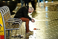 Saturday 21 December 2013<br /> Pictured: A man with his head  what  in Cardiff's Queen Street appears to be a heavy night<br /> Re: Black Friday Drinkers