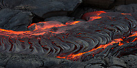 Ribbons of Lava: Hot lava pooling creates a ribbon-like surface of new land, 61g flow, Hawai'i Volcanoes National Park, Big Island.