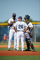 GCL Rays relief pitcher Jhoanbert Cedeno (20) talks with pitching coach Alberto Bastardo (26) and catcher Michael Berglund during a game against the GCL Twins on August 9, 2018 at Charlotte Sports Park in Port Charlotte, Florida.  GCL Twins defeated GCL Rays 5-2.  (Mike Janes/Four Seam Images)