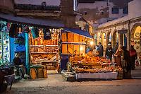 Essaouira, Morocco.  Women Examining  Souvenir Items Made of Thuya Wood.