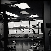Airplane being loaded seen through airport teminal window<br />