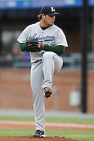 Lexington Legends Carlos Quevedo #27 delivers a pitch during a game against  the Lexington Legends at McCormick Field in Asheville,  North Carolina;  April 16, 2011. Lexington defeated Aheville 13-7.  Photo By Tony Farlow/Four Seam Images