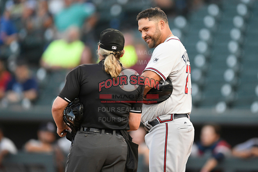 Umpire Jennifer Pawol talks with Rome Braves manager Matt Tuiasosopo (27) during a game between the Columbia Fireflies and Rome Braves on Tuesday, June 4, 2019, at Segra Park in Columbia, South Carolina. Columbia won, 3-2. (Tom Priddy/Four Seam Images)