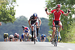 Pix: Shaun Flannery/shaunflanneryphotography.com...COPYRIGHT PICTURE>>SHAUN FLANNERY>01302-570814>>07778315553>>..16th September 2012..Doncaster Wheelers Autumn Road Race..Harworth, Doncaster..Jonathan Stanlake of Stockport celebrates victory over Peter Fielding-Smith of Richardsons RT.