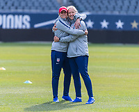 CHICAGO, IL - OCTOBER 5: Jill Ellis of the United States hugs Dawn Scott at Soldier Field on October 5, 2019 in Chicago, Illinois.