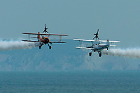 BNPS.co.uk (01202 558833)<br /> Pic: Graham Hunt/BNPS<br /> Date: 2nd September 2021.<br /> <br /> Aero Super Batics wing walkers in action on day 1 of Bournemouth Air Festival in Dorset on a warm overcast day.