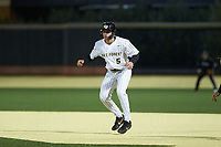 Pierce Bennett (5) of the Wake Forest Demon Deacons takes his lead off of first base against the Louisville Cardinals at David F. Couch Ballpark on March 6, 2020 in  Winston-Salem, North Carolina. The Cardinals defeated the Demon Deacons 4-1. (Brian Westerholt/Four Seam Images)