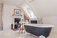 BNPS.co.uk (01202) 558833. <br /> Pic: Strutt&Parker/BNPS<br /> <br /> Pictured: Bathroom. <br /> <br /> A grand Georgian manor where writer Evelyn Waugh lived and died is on the market for £5.5m.<br /> <br /> The author of Vile Bodies, Brideshead Revisited and Sword of Honour bought Combe Florey House in Somerset in 1956 and his family lived there until 2008 when they sold it to the current owners.<br /> <br /> In Waugh's day the house was often filled with his glamorous and clever guests like poet John Betjeman, actors Peter Cook and Alec Guinness and writers Salman Rushdie and Muriel Spark.<br /> <br /> The 12-bedroom house has had a makeover since Waugh's day and quirky style and is now a light-filled spacious family home with a party barn, swimming pool and 34 acres.