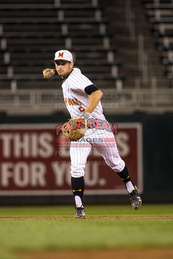 Brandon Lowe (5) of the Maryland Terrapins throws during a 2015 Big Ten Conference Tournament game between the Maryland Terrapins and Michigan State Spartans at Target Field on May 20, 2015 in Minneapolis, Minnesota. (Brace Hemmelgarn/Four Seam Images)