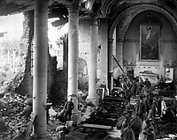 This shattered church in the ruins of Neuvilly furnished a temporary shelter for American wounded being treated by the 110th Sanitary Train, 4th Ambulance Corps.  France, September 20, 1918. Sgt. J. A. Marshall. (Army)<br />NARA FILE #:  111-SC-24942<br />WAR & CONFLICT BOOK #:  667