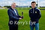 Killian Falvey from Aunascaul receiving the Munster GAA U20 Footballer of the Year Award 2020 from Dermot Lynch, Treasurer of the Munster GAA Council.