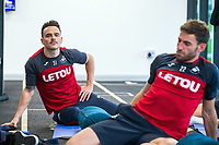 (L-R) Roque Mesa and Angel Rangel exercise in the gym during the Swansea City training session at The Fairwood training Ground, Swansea, Wales, UK. Thursday 16 November 2017