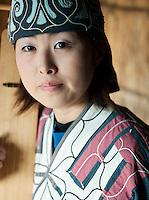 An Ainu woman playing a Tonkori in the Ainu Museum. The Ainu people are indigenous to Japan and Russia. Lake Poroto, Hokkaid?, Japan