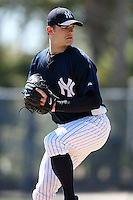 February 25, 2010:  Pitcher David Robertson of the New York Yankees signs autographs after practice at Legends Field in Tampa, FL.  Photo By Mike Janes/Four Seam Images