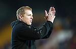 St Johnstone v Celtic.....26.12.13   SPFL<br /> Neil Lennon applauds the Celtic fans<br /> Picture by Graeme Hart.<br /> Copyright Perthshire Picture Agency<br /> Tel: 01738 623350  Mobile: 07990 594431
