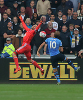 Lukasz Fabianski of Swansea fails to catch the ball, Harry Kane of Tottenham Hotspur fails to score during the Barclays Premier League match between Swansea City and Tottenham Hotspur played at The Liberty Stadium, Swansea on October 4th 2015