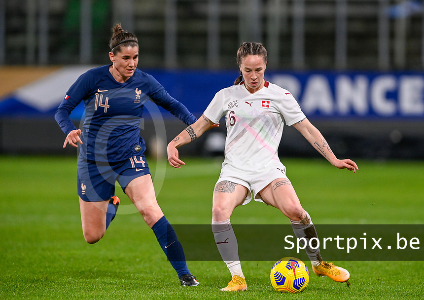 French Charlotte Bilbault (14) pictured fighting for the ball with Swiss Geraldine  Reuteler (6) during the Womens International Friendly game between France and Switzerland at Stade Saint-Symphorien in Longeville-lès-Metz, France.