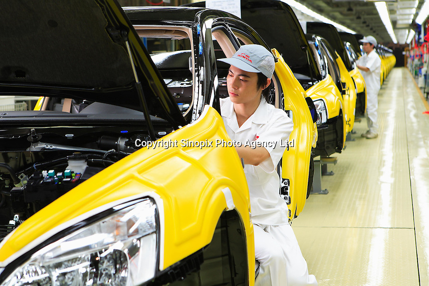 The production line of the Honda Accord at the new Guangzhou Honda Automobile Co Ltd factory. The plant built at a cost of 140 million US$ is one of the most advanced car plants in the world. It has a state of the art production line as well as the world's first total water re-cycling sytem..