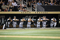 The Wake Forest Demon Deacons dugout watches the action during the game against the West Virginia Mountaineers in Game Four of the Winston-Salem Regional in the 2017 College World Series at David F. Couch Ballpark on June 3, 2017 in Winston-Salem, North Carolina.  The Demon Deacons walked-off the Mountaineers 4-3.  (Brian Westerholt/Four Seam Images)