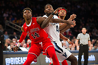 NEW YORK, NY - Thursday March 9, 2017: Kassoum Yakwe (#14) of St. John's and Eric Paschall (#4) of Villanova fight for position as the two schools square off in the Quarterfinals of the Big East Tournament at Madison Square Garden.