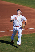 Peoria Javelinas Chad Wallach (22), of the Cincinnati Reds organization, tracks a popup foul ball during a game against the Mesa Solar Sox on October 19, 2016 at Peoria Stadium in Peoria, Arizona.  Peoria defeated Mesa 2-1.  (Mike Janes/Four Seam Images)