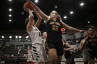 Pea Ridge forward Sydney Spears (4) shoots as Prairie Grove center Olivia Kestner (55) covers, Friday, January 8, 2021 during a basketball game at Pea Ridge High School in Pea Ridge. Check out nwaonline.com/210108Daily/ for today's photo gallery. <br /> (NWA Democrat-Gazette/Charlie Kaijo)