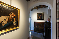 Switzerland. Canton Ticino. Bigorio. Monastery. Convento Santa Maria dei Frati Cappuccini. Fra Roberto Pasotti. The Order of Friars Minor Capuchin is an order of friars within the Catholic Church, among the chief offshoots of the Franciscans. Antique religious painting on the wall.18.12.2018 © 2018 Didier Ruef