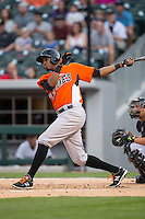 Michael Almanzar (13) of the Norfolk Tides follows through on his swing against the Charlotte Knights at BB&T BallPark on April 9, 2015 in Charlotte, North Carolina.  The Knights defeated the Tides 6-3.   (Brian Westerholt/Four Seam Images)