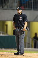 Home plate umpire Derek Mollica during the International League game between the Gwinnett Braves anf the Charlotte Knights at BB&T Ballpark on August 19, 2014 in Charlotte, North Carolina.  The Braves defeated the Knights 10-5.   (Brian Westerholt/Four Seam Images)