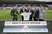 Lee Trundle (2nd L) with match sponsors during the Barclays Premier League match between Swansea City and Chelsea at the Liberty Stadium, Swansea on April 9th 2016