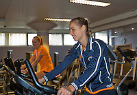 Moskou, Russia, Februari 4, 2016,  Fed Cup Russia-Netherlands,  Dutch team in fitness center, Arantxa Rus and Kiki Bertens (background) on the bike<br /> Photo: Tennisimages/Henk Koster