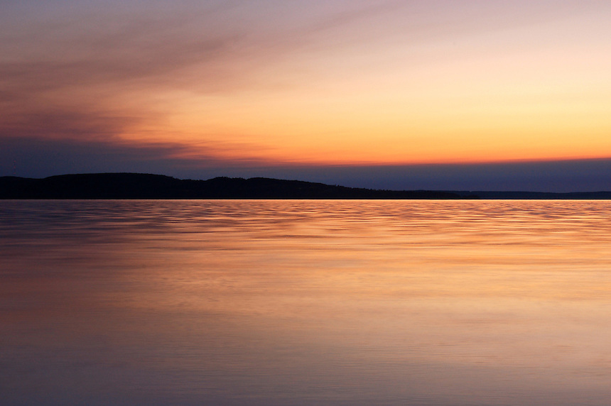 The sun setting over Munising, MI and Lake Superior on a late summer evening. Munising, Michigan - Upper Peninsula
