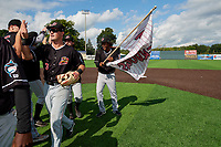 Batavia Muckdogs Nic Ready (3) and Ronal Reynoso (2) high five teammates after clinching the Pinckney Division Title during a NY-Penn League game against the Auburn Doubledays on September 2, 2019 at Falcon Park in Auburn, New York.  Batavia defeated Auburn 7-0 to clinch the Pinckney Division Title.  (Mike Janes/Four Seam Images)
