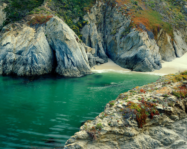 Emerald-colored water in China Cove on the Pacific Ocean; Point Lobos State Reserve, CA