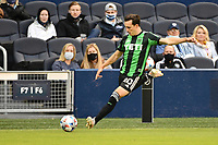 KANSAS CITY, KS - MAY 9: Jared Stroud #20 Austin FC crosses the ball during a game between Austin FC and Sporting Kansas City at Children's Mercy Park on May 9, 2021 in Kansas City, Kansas.