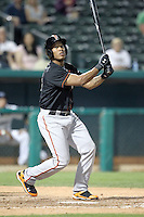 Thomas Neal #21 of the Fresno Grizzlies plays in a Pacific Coast League game against the Tucson Padres at Kino Stadium on April 20, 2011  in Tucson, Arizona. .Photo by:  Bill Mitchell/Four Seam Images.
