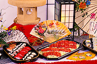 A delicious assortment of sushi and sashimi platters set on a Japanese-inspired table.