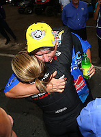 Feb 22, 2015; Chandler, AZ, USA; NHRA pro stock driver Rodger Brogdon is congratulated by Erica Enders-Stevens as he celebrates after winning the Carquest Nationals at Wild Horse Pass Motorsports Park. Mandatory Credit: Mark J. Rebilas-