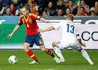 Spain's Andres Iniesta and Finland's Arkivuo during international match of the qualifiers for the FIFA World Cup Brazil 2014.March 22,2013.(ALTERPHOTOS/Victor Blanco)