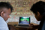 Fishing Cat (Prionailurus viverrinus) biologists, Maduranga Ranaweera  and Anya Ratnayaka, reviewing camera trap images, Urban Fishing Cat Project, Sigiriya, Sri Lanka