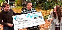 Pictured: £1million winner Wayne Rowles (C), with daughter Laura (R), and his brother Terence Rowles (L)<br />