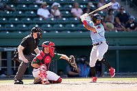 Shortstop Ezequiel Duran (17) of the Hickory Crawdads in a game against the Greenville Drive on Sunday, August 29, 2021, at Fluor Field at the West End in Greenville, South Carolina. The catcher is Stephen Scott (23) and the umpire is Mitch Leikam. (Tom Priddy/Four Seam Images)