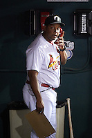 Glendale Desert Dogs pitching coach Dernier Orozco (22), of the St. Louis Cardinals organization, calls the bullpen during a game against the Salt River Rafters on October 19, 2016 at Camelback Ranch in Glendale, Arizona.  Salt River defeated Glendale 4-2.  (Mike Janes/Four Seam Images)