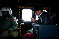 Oruro, Bolivia<br /> A picture dated January 12, 2015 shows Bolivian President Evo Morales checking his mobile phone in his helicopter flying in the Bolivian Altiplano.