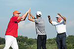 Luis Garcia (in grey), Boris Becker (in red) and Mark O'Meara (in white) congratulate themselves after playing basketball at the 17th hole during the World Celebrity Pro-Am 2016 Mission Hills China Golf Tournament on 22 October 2016, in Haikou, China. Photo by Weixiang Lim / Power Sport Images